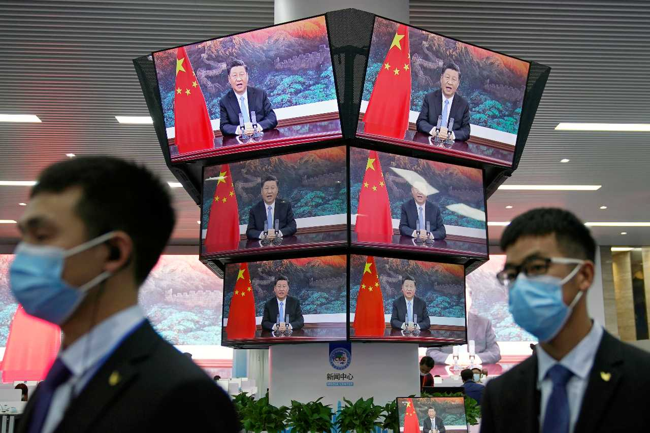 Photo: China's President Xi Jinping is seen on screens in the media center as he speaks at the opening ceremony of the third China International Import Expo (CIIE) in Shanghai, China November 4, 2020. Credit: REUTERS/Aly Song