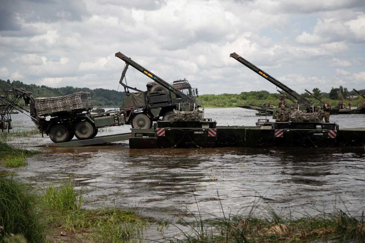 Photo: US Army truck drives onto amphibious rig on the river Neman in Lithuania during US-led exercise Saber Strike 18 taking place across the Baltics and Poland. It involves around 18,000 troops from 19 NATO Allies and partners. The exercise is aimed at building readiness in an integrated training environment. Credit: NATO