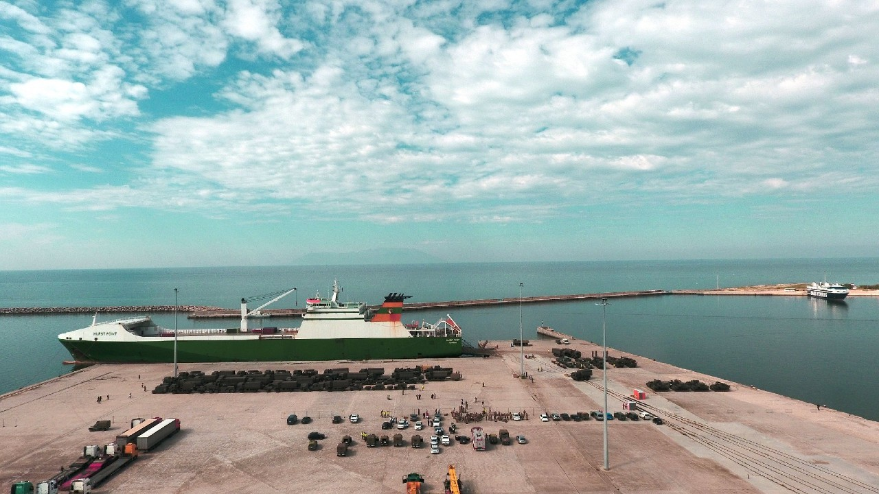 """Photo: HURST POINT """"RORO"""" London, UK ship arrival at Alexandroupolis Sea- Port-Greece. Greek Armed forces contributed along with the local police and sea-port authorities ensuring the safety and smooth disembarkation of the UK military vehicles and trucks, on May 30, 2017. Credit: NATO"""
