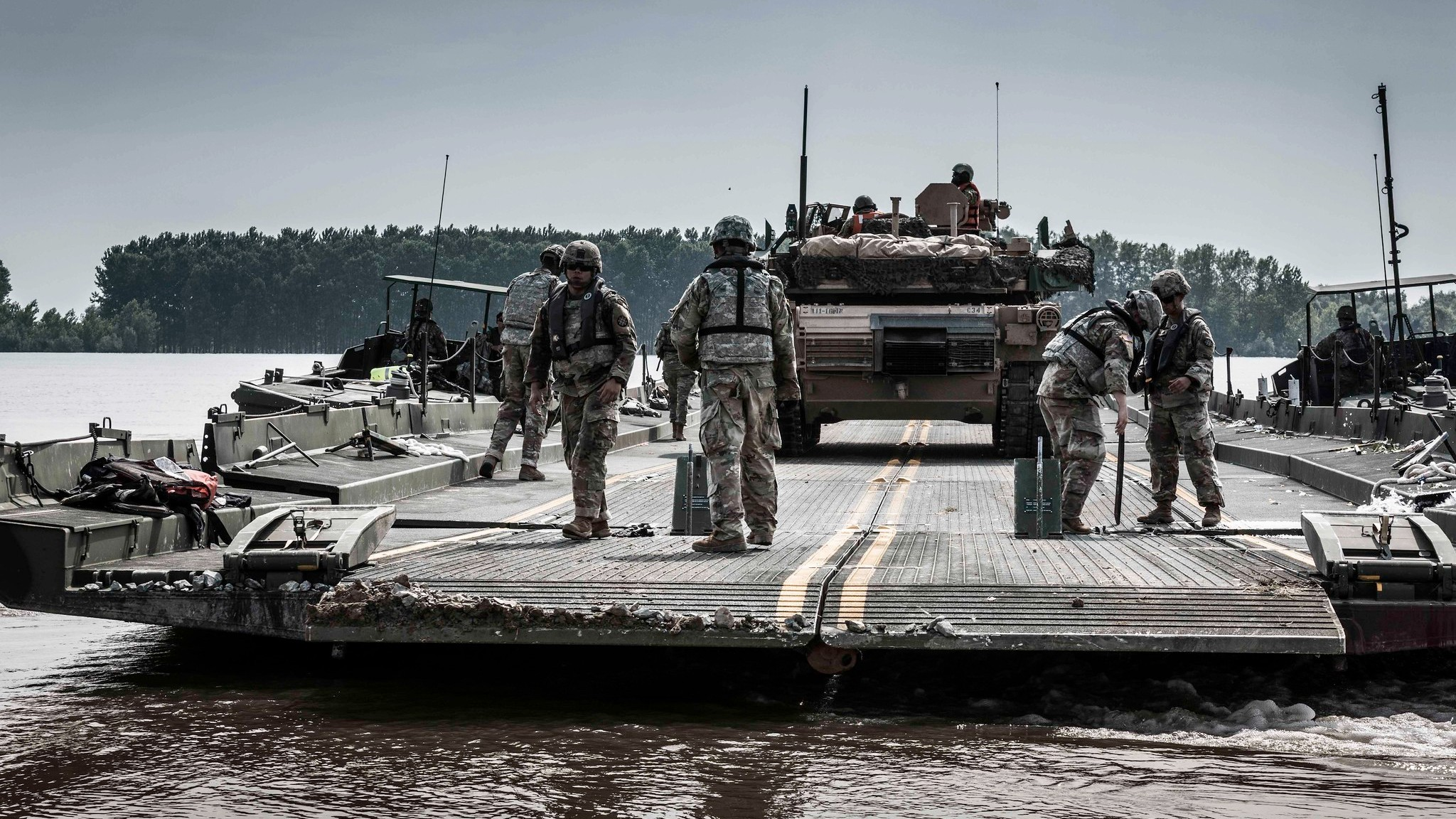 Photo: A U.S. Army M1 Abrams tank is transported across the Danube River in Romania during Exercise Saber Guardian 2019. The exercise includes more than 8,000 soldiers from six NATO Allied and partner nations. It's co-led by Romanian Land Forces and U.S. Army Europe. Credit: NATO