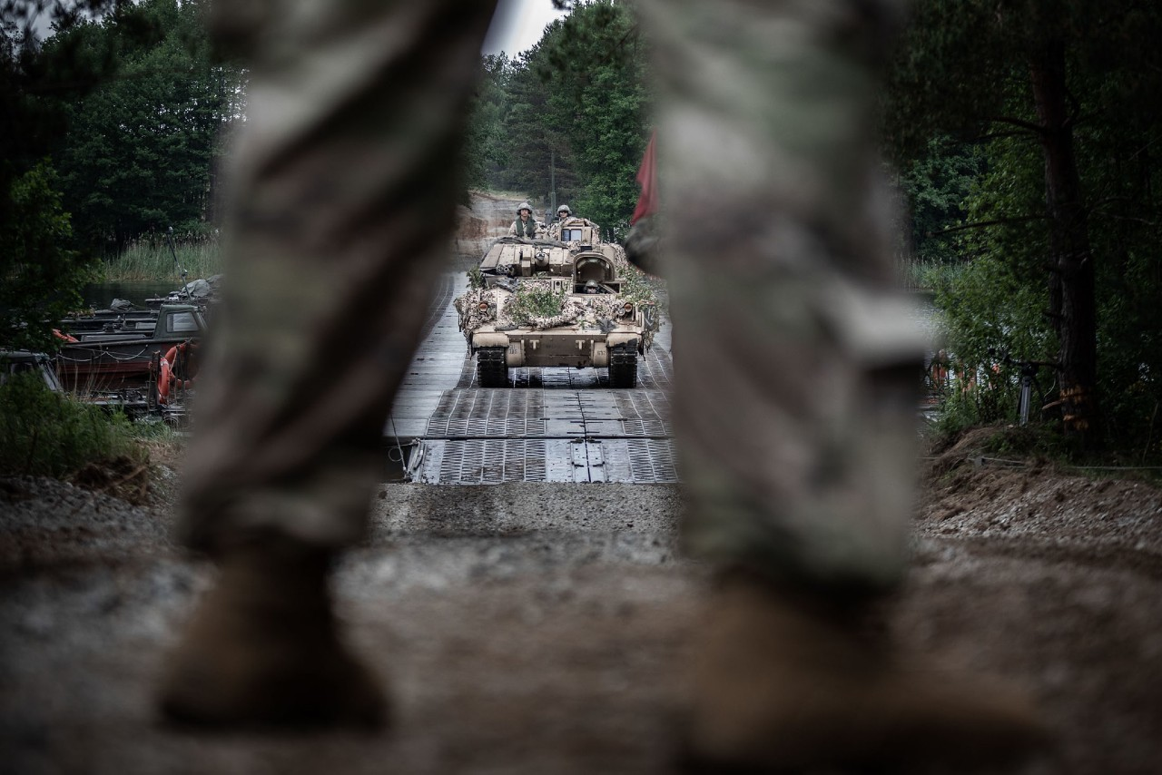 Photo: A US Army Bradley fighting vehicle crosses a Polish floating bridge at Zły Łęg lake during Exercise Allied Spirit. Part of DEFENDER-Europe 20 Plus, Allied Spirit brings together more than 6,000 Polish and US Army troops for combat and mobility drills. Credit: NATO