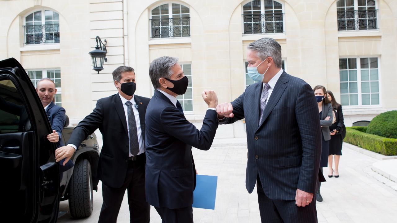 Photo: Secretary-General Mathias Cormann greeting U.S. Secretary of State Antony Blinken at the OECD. Credit: OECD / Maud Bernos