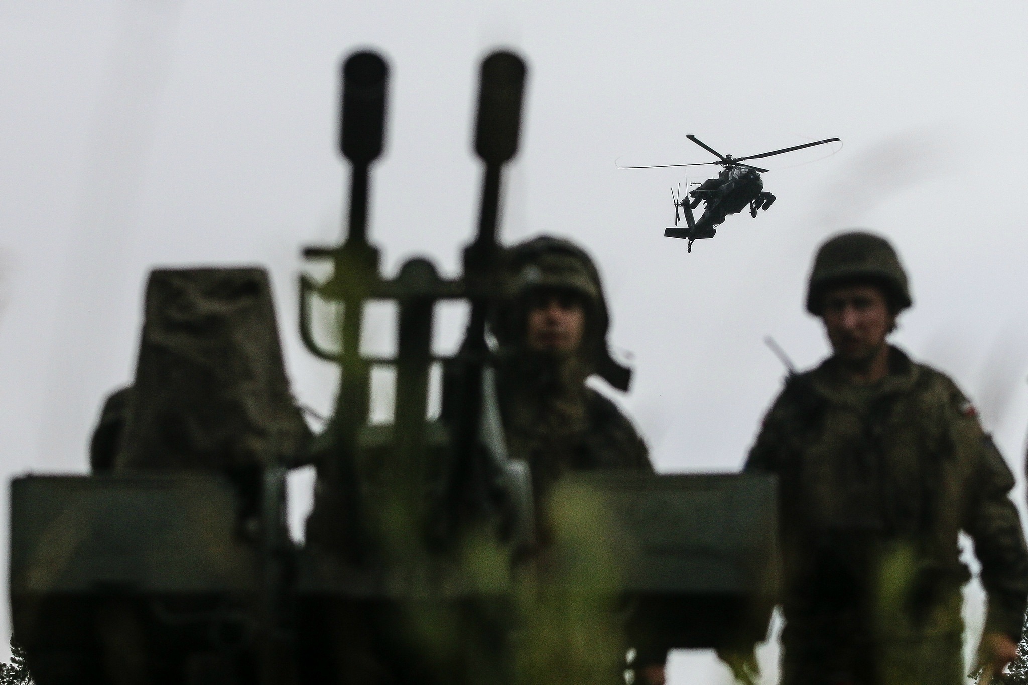 Polish army soldiers with the 15th Mechanized Brigade, post security on a heavy machine gun while receiving aerial support from U.S. Army AH-64 Apache helicopters with Battle Group Poland, during a multinational training event for exercise Puma 2 with Battle Group Poland at Bemowo Piskie Training Area, Poland, June 14, 2018, as part of Saber Strike 18. This year's exercise, which runs from June 3-15, tests allies and partners from 19 countries on their ability work together to deter aggression in the region and improve each unit's ability to perform their designated mission. (U.S. Army photo by Spc. Hubert D. Delany III)