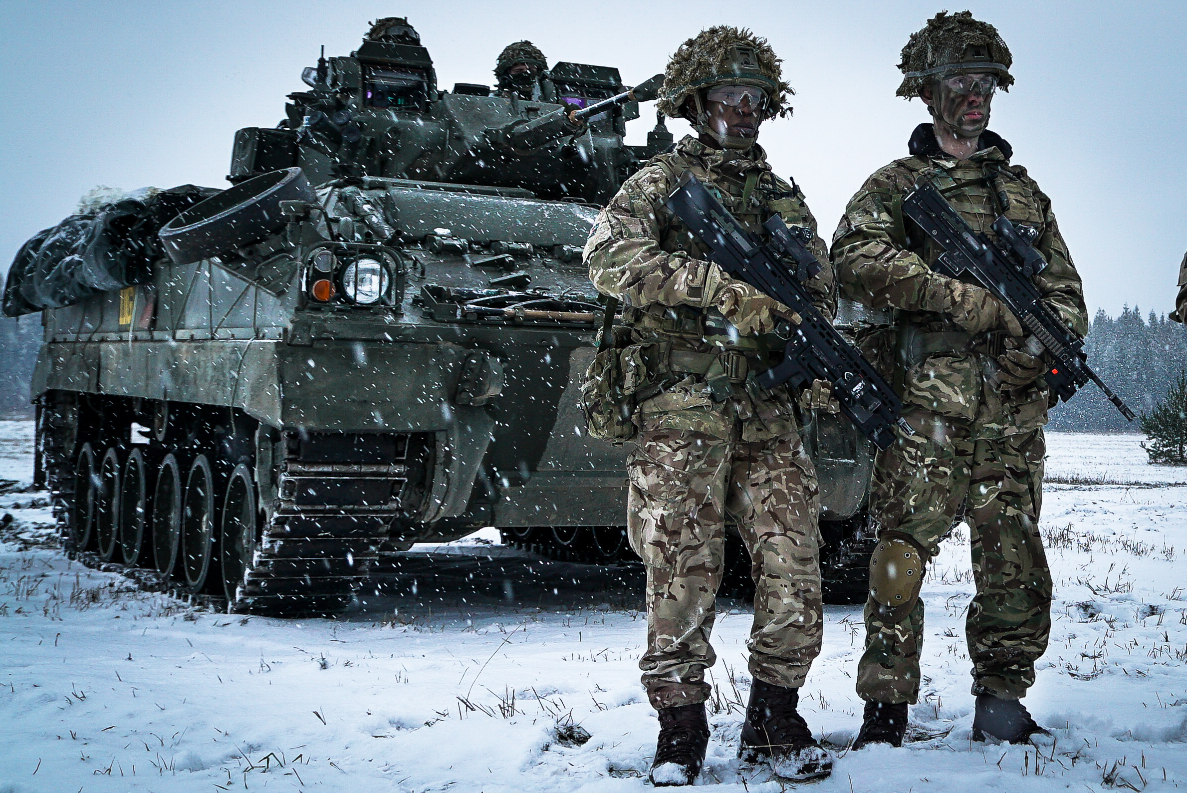 Soldiers from the British Army's Royal Welsh Regiment stand in front of their Warrior armoured fighting vehicle near a base in Tapa, Estonia. These troops form part of NATO's Enhanced Forward Presence in the East of the Alliance.