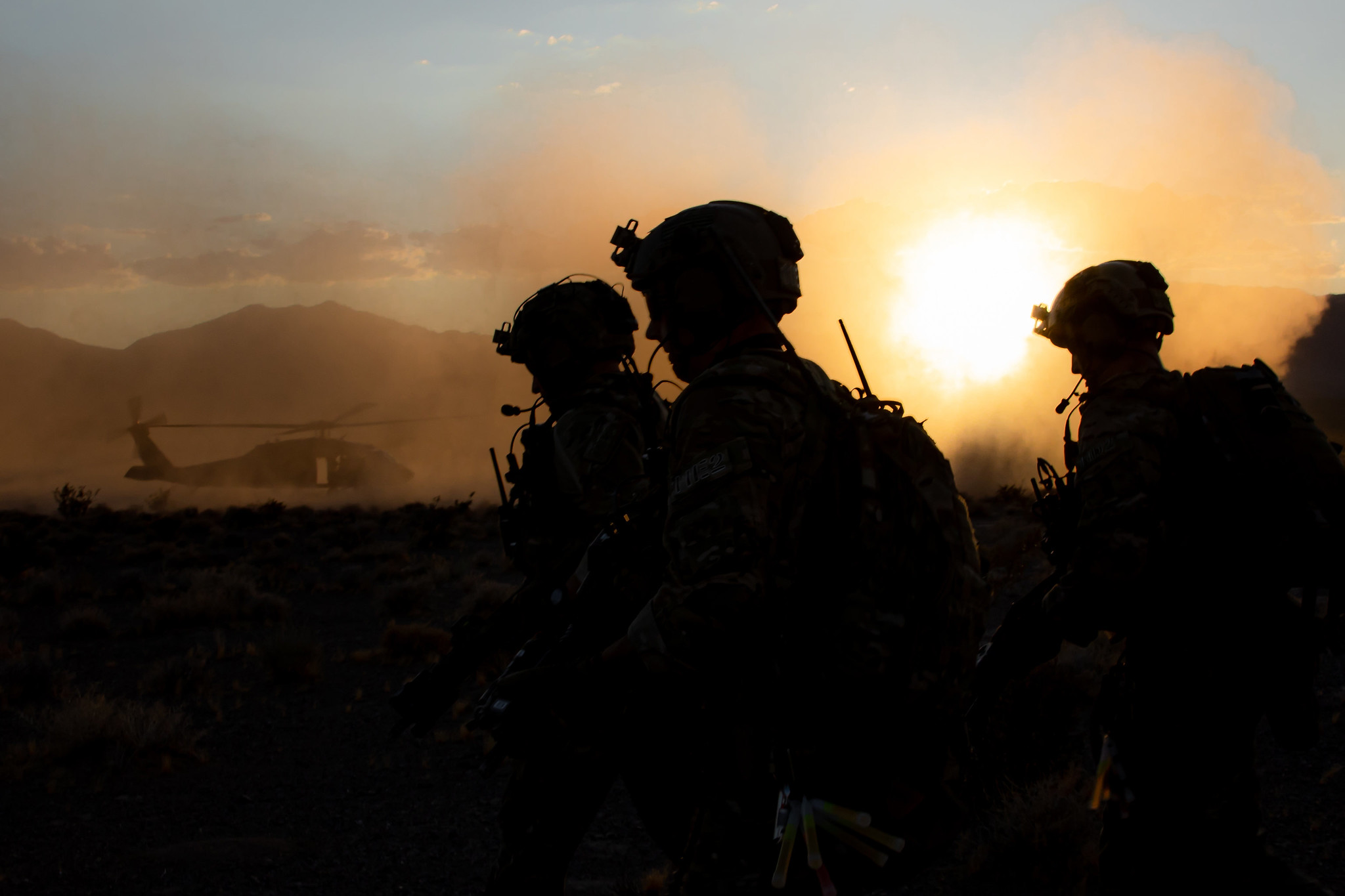 Green Berets assigned to 3rd Special Forces Group (Airborne) move to load onto a UH-60 Blackhawk helicopter for extraction during a training event near Nellis Air Force Base, Nev. Aug. 27, 2019. U.S. Special Forces and U.S. Air Force Joint Terminal Attack Controllers conducted a raid and utilized multiple weapon systems ranging from smalls arms weapons to A-10 Thunderbolt ll aircraft. (U.S. Army photo by Sgt. Steven Lewis)