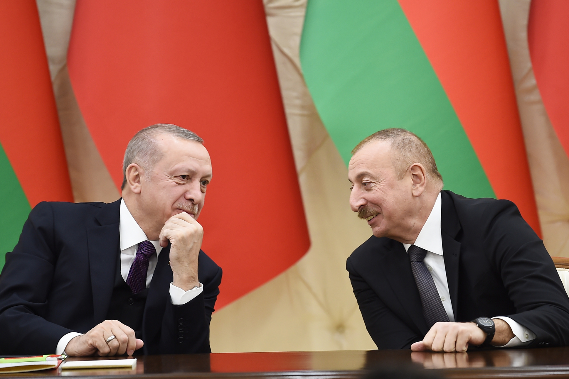 Photo: President Ilham Aliyev of Azerbaijan (right) signs a bilateral agreements with President Recep Tayyip Erdoğan of Turkey, February 25, 2020. Credit: President Administration of Azerbaijan
