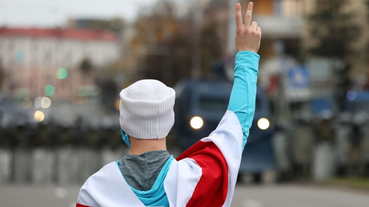 Photo: MINSK, BELARUS - OCTOBER 25, 2020: An opposition activist makes a V-sign during an unauthorized protest. Mass protests organized by the opposition have been taking place in Belarus after the 9 August presidential election. Credit: Stringer/TASS.