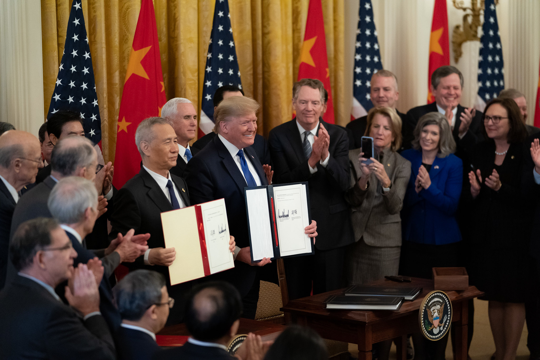 Photo: President Donald J. Trump, joined by Chinese Vice Premier Liu He, sign the U.S. China Phase One Trade Agreement Wednesday, Jan. 15, 2020, in the East Room of the White House. Credit: Official White House Photo by Tia Dufour