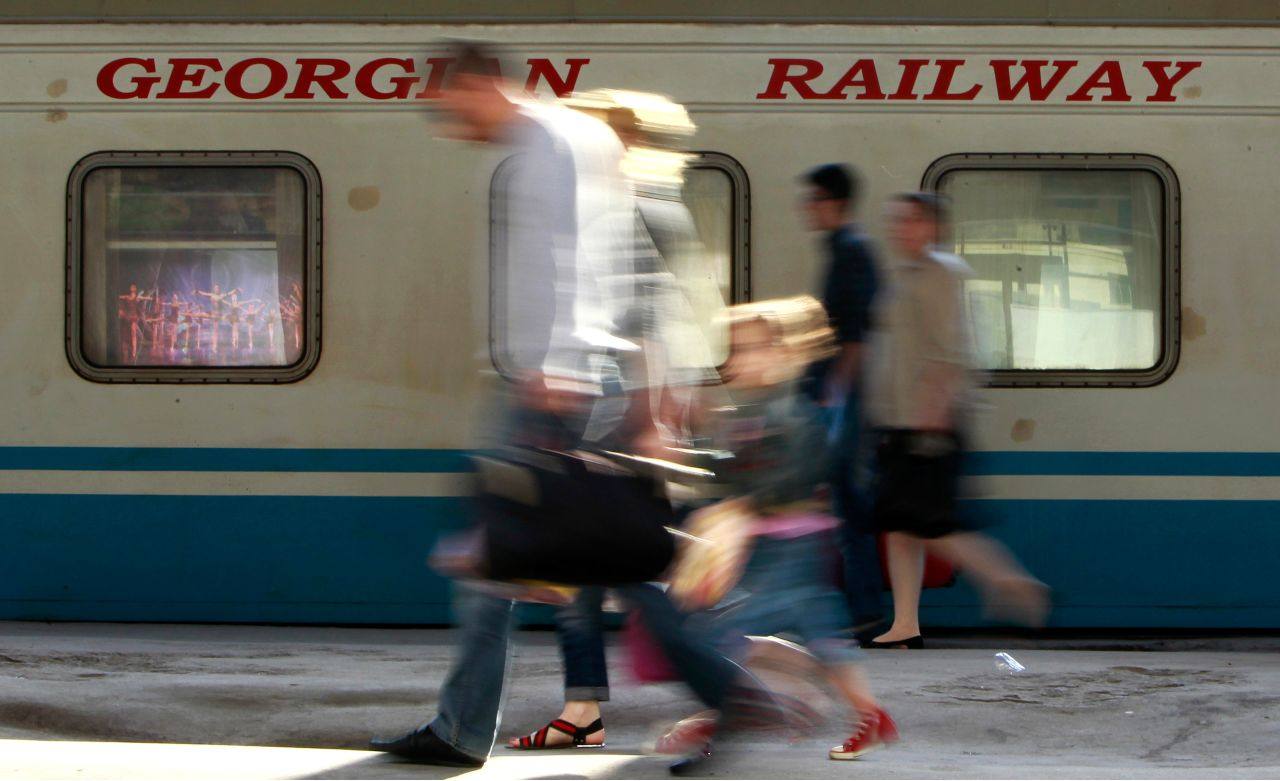 Photo: Passengers walk past a Georgian Railway train at the railway station in Tbilisi, June 6, 2012. Georgia postponed a planned London listing of its state railways monopoly in May, dealing a fresh blow to IPO markets as investors struggle with volatile share prices and reel from the debacle of Facebook's flotation. Picture taken June 6. Credit: REUTERS/David Mdzinarishvili