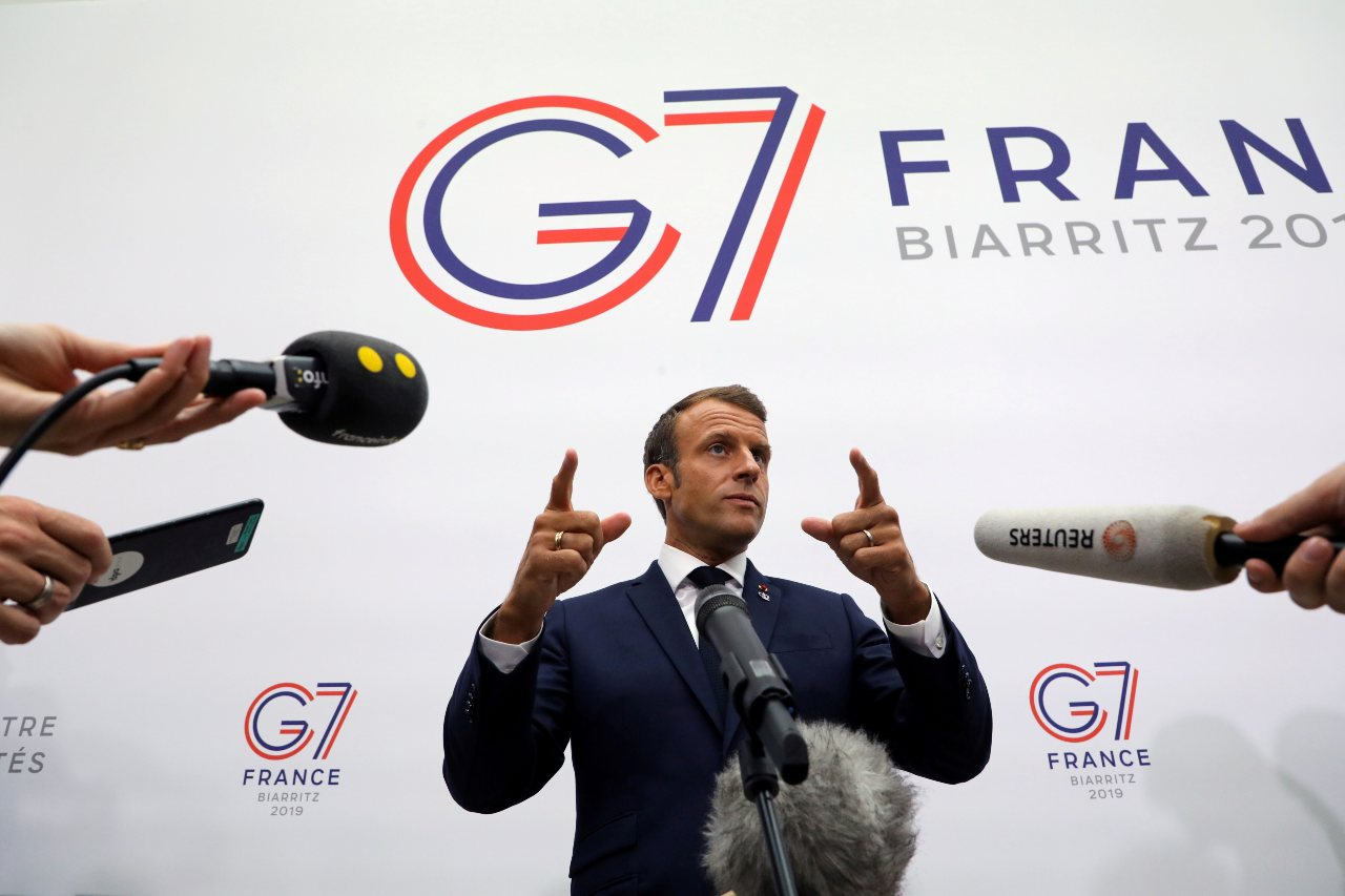 Photo: France's President Emmanuel Macron gestures as he speaks to the press after a plenary session at the Bellevue centre in Biarritz, France August 25, 2019. Credit: Ludovic Marin/Pool via REUTERS.