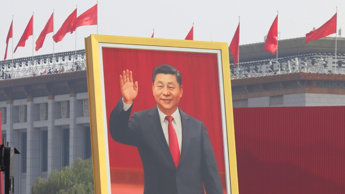 Photo: The portrait of China's President Xi Jinping appears during a military parade to celebrate the 70th anniversary of the founding of a nation at the Tiananmen Square in Beijing, China on October 1, 2019. New weapons were unveiled at the largest military parade ever. ( The Yomiuri Shimbun ) Credit: REUTERS