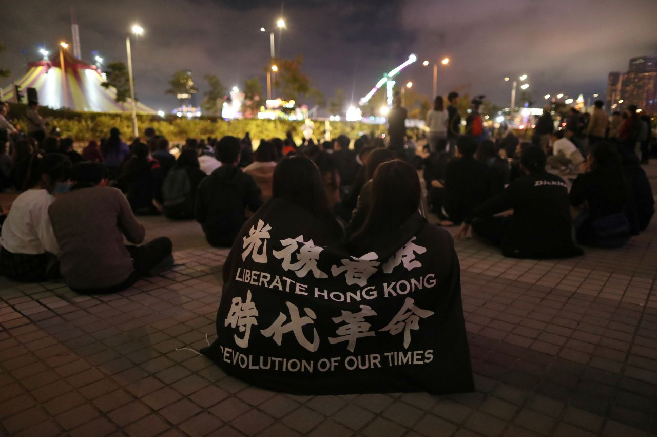 Photo: Protesters rally to remember the deaths and injuries during the months of protests, in Edinburgh Place in Hong Kong, China, December 30, 2019. Credit: REUTERS/Lucy Nicholson.