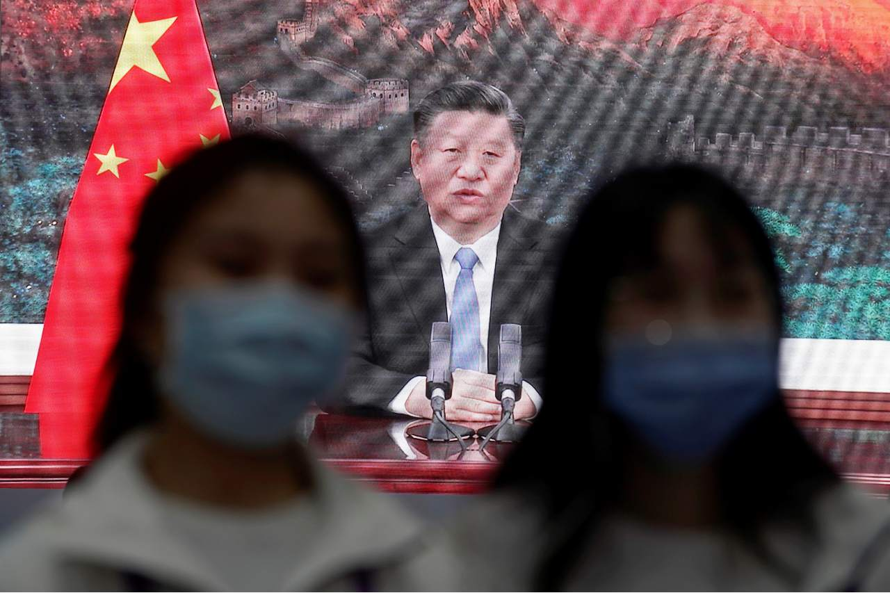Photo: China's President Xi Jinping is seen on a screen in the media center as he speaks at the opening ceremony of the third China International Import Expo (CIIE) in Shanghai, China November 4, 2020. Credit: REUTERS/Aly Song