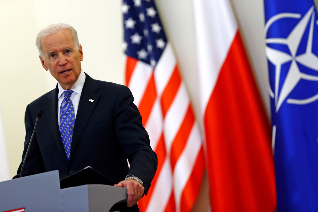 "U.S. Vice President Joe Biden addresses to media after meeting Polish President Bronislaw Komorowski in Warsaw March 18, 2014. Biden told NATO allies in eastern Europe on Tuesday that the alliance was unwavering in its commitment to protect them from attack, offering reassurance after what he called Russia's ""land grab"" in Ukraine's Crimea REUTERS/Kacper Pempel"
