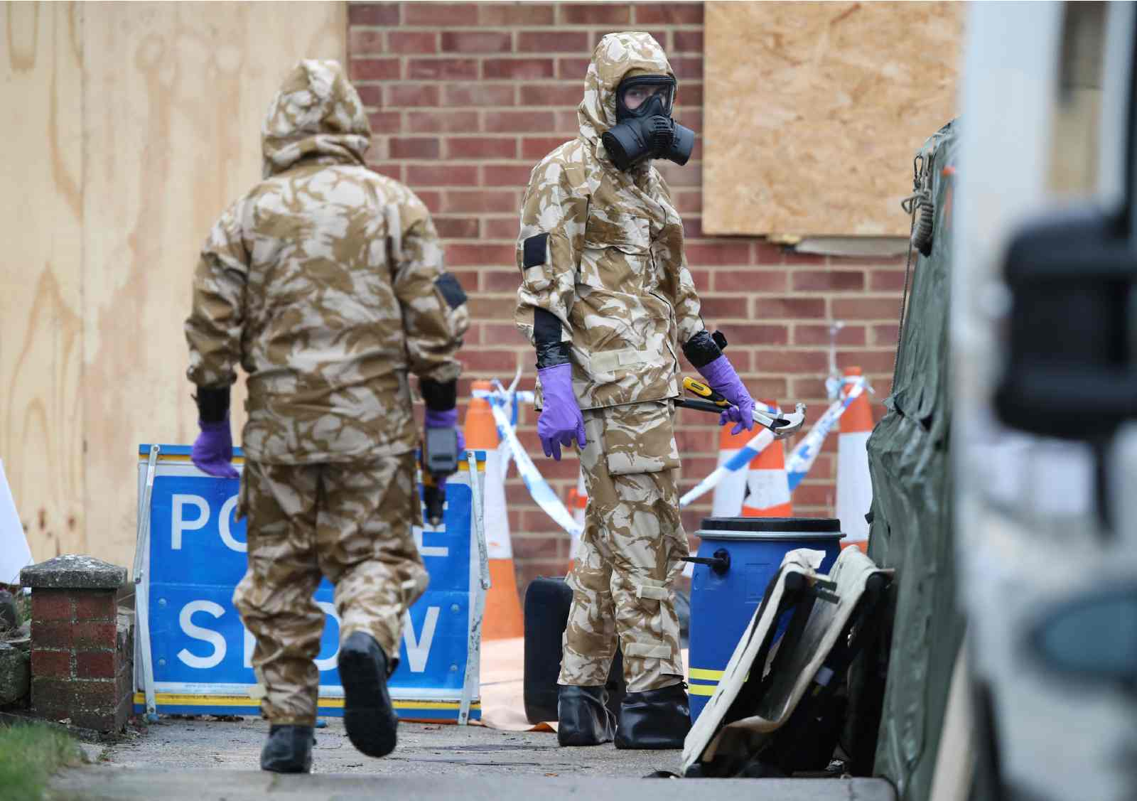 Members of the military wear protective clothing as work continues on the home of former Russian spy Sergei Skripal in Salisbury, Wiltshire. The property is to be dismantled, with the roof completely removed by military teams in the wake of the Novichok attack as decontamination work continues.
