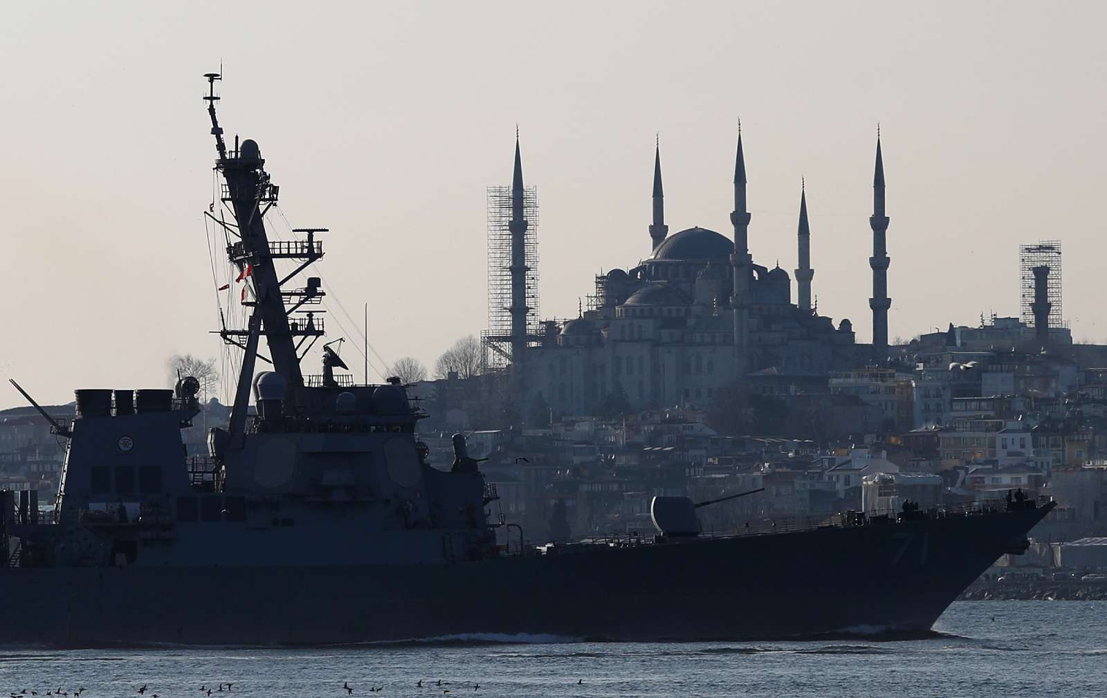 U.S. Navy guided-missile destroyer USS Ross, with the Blue mosque in the background, sails in the Bosphorus, on its way to the Black Sea, in Istanbul, Turkey, February 23, 2020. REUTERS/Murad Sezer