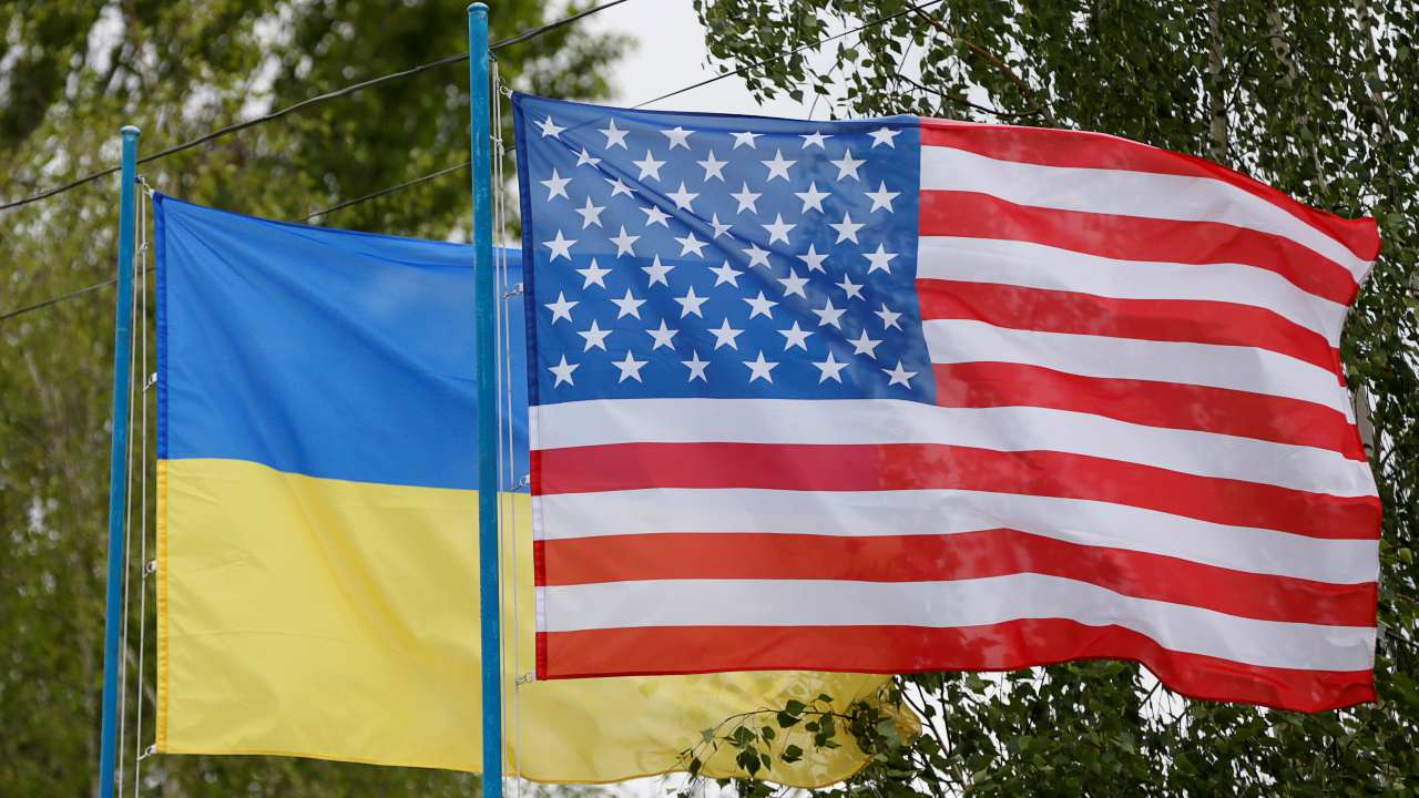 National flags of Ukraine and the U.S. fly at a compound of a police training base outside Kiev, Ukraine, May 6, 2016. Picture taken May 6, 2016. REUTERS/Valentyn Ogirenko
