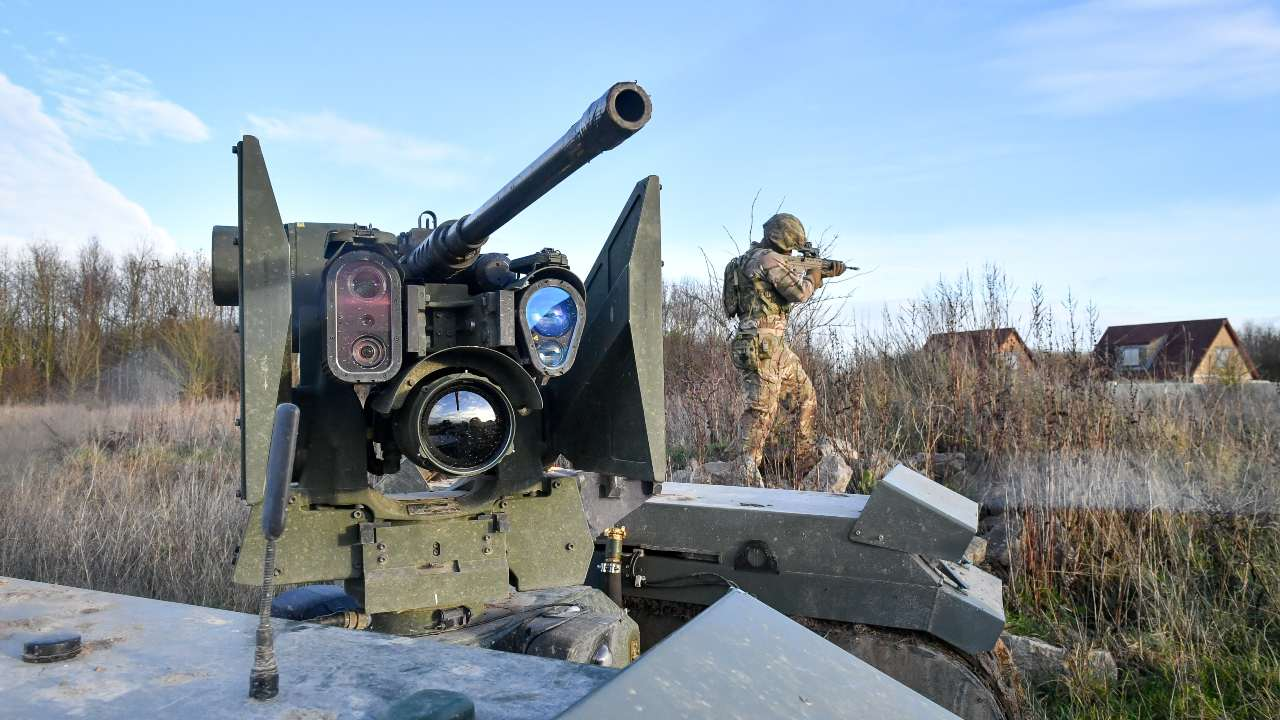 The barrel and sight equipment on top of a Titan Strike unmanned ground vehicle, equipped with a .50 Caliber machine gun, moves and secures ground on Salisbury Plain during exercise Autonomous Warrior 18, where military personnel, government departments and industry partners are taking part in Exercise Autonomous Warrior, working with NATO allies in a groundbreaking exercise to understand how the military can exploit technology in robotic and autonomous situations. PA Images via REUTERS