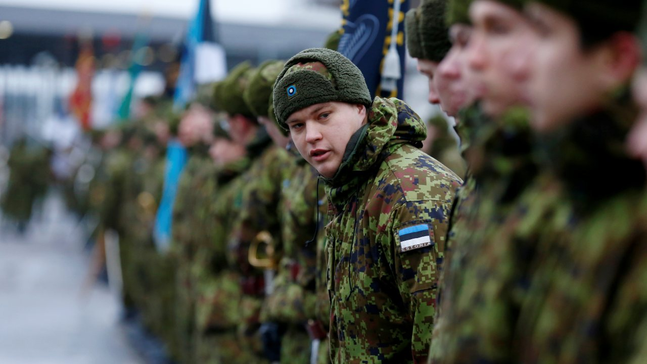 Photo: Estonian soldiers get ready for the commemoration of the centennial of the War of Independence ceasefire near the border crossing point with Russia in Narva, Estonia January 3, 2020. Credit: REUTERS/Ints Kalnins