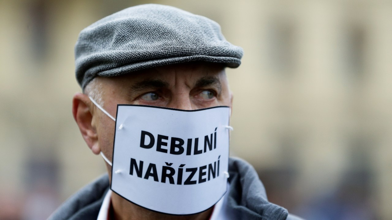 "A demonstrator wearing a mask reading ""stupid restrictions"" looks on during a protest against the Czech government's restrictions as the spread of the coronavirus disease (COVID-19) continues in Prague, Czech Republic, October 28, 2020. REUTERS/David W Cerny"