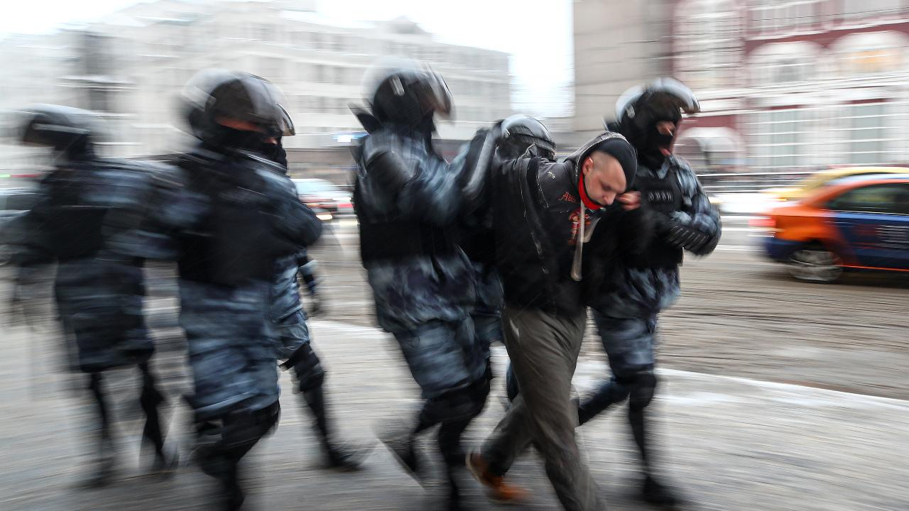 Riot police officers detain a participant in an unauthorized rally in support of Russian opposition activist Alexei Navalny in Komsomolskaya Square. In connection with calls for protests, pedestrian movement and public transport have been restricted in central Moscow. Access to several stations of the Moscow Metro has been temporarily closed, with trains passing without stopping. Valery Sharifulin/TASS.