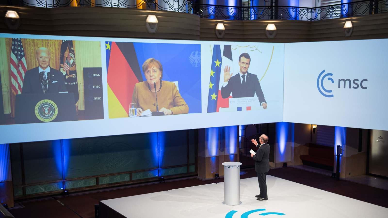 Joe Biden, Angela Merkel, and Emmanuel Macron just before delivering their remarks