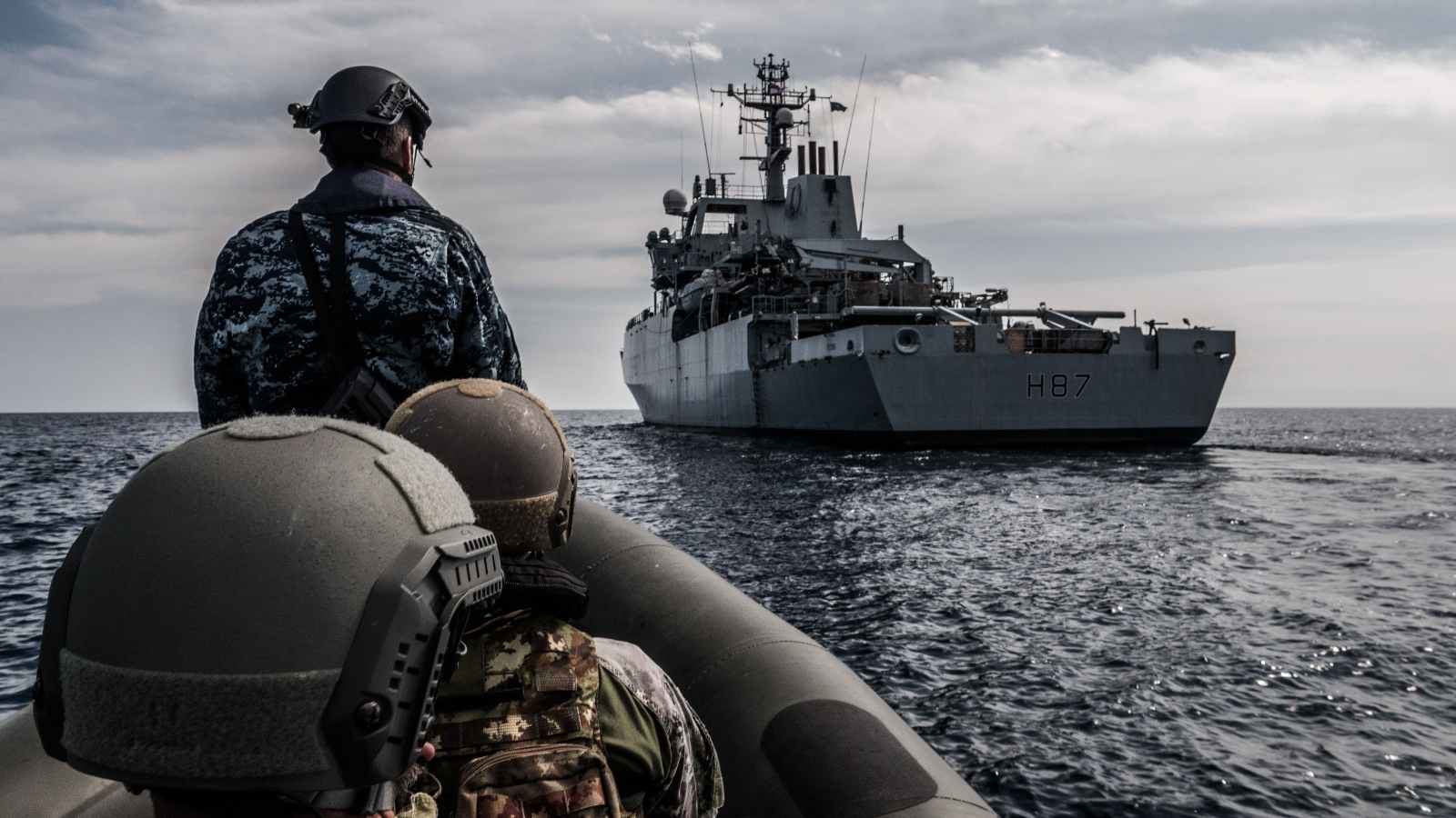 Combined Italian and Croatian boarding team approach British Royal Navy vessel HMS Echo during a boarding exercise on Operation Sea Guardian.