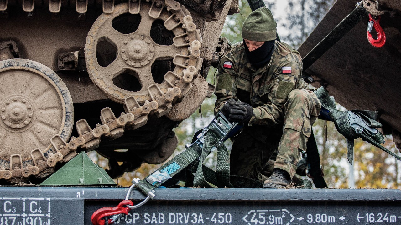 Photo: Polish soldier secures a tracked vehicle to a heavy equipment transport during Exercise Brilliant Jump 2020. Credit: NATO