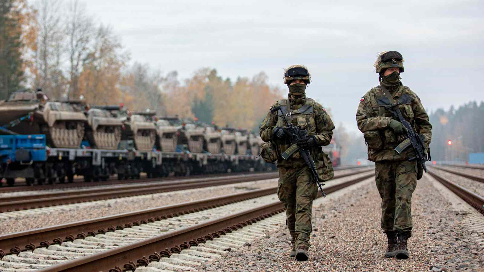 Polish soldiers patrol the rail yard at Mockava, Lithuania during Exercise Brilliant Jump 20. Brilliant Jump is a deployment exercise designed to test the readiness of NATO's spearhead unit, the Very High Readiness Joint Task Force. The VJTF deployed to Lithuania by land, air and sea to take part in the Lithuanian national exercise Iron Wolf II. To avoid the spread of COVID-19, the deploying forces avoided civilian populations on their way to Lithuania and practiced social distancing.