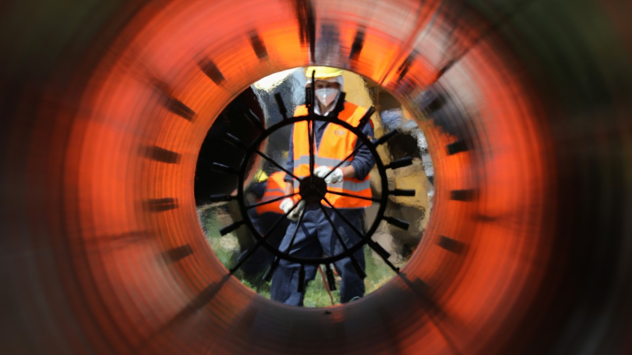 Photo: Workers are seen through a pipe at a construction site on the extension of Russia's TurkStream gas pipeline ahead of the visit of Serbia's President Aleksandar Vucic and Bulgaria's Prime Minister Boyko Borissov, in Letnitsa, Bulgaria, June 1, 2020. Credit: REUTERS/ Stoyan Nenov