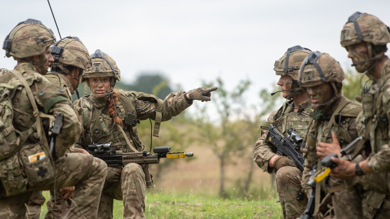 Photo: Officer cadet Peony Grainger, 24, leads a platoon attack in West Tofts Camp, Thetford, Norfolk, during the British Army Exercise Dynamic Victory which is usually held overseas with alongside coalition forces but is taking place in UK due to Covid-19 restrictions. Credit: PA via Reuters