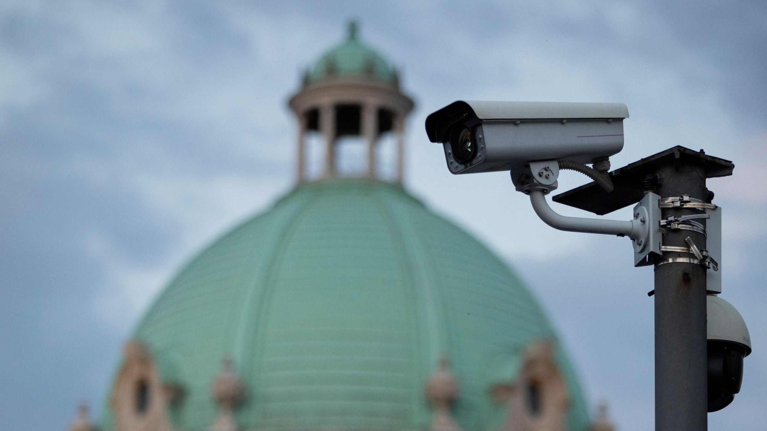 Photo: Surveillance camera is seen in front of the Serbian Parliament building in Belgrade, Serbia, August 12, 2020. Picture taken August 12, 2020. Credit: REUTERS/Marko Djurica