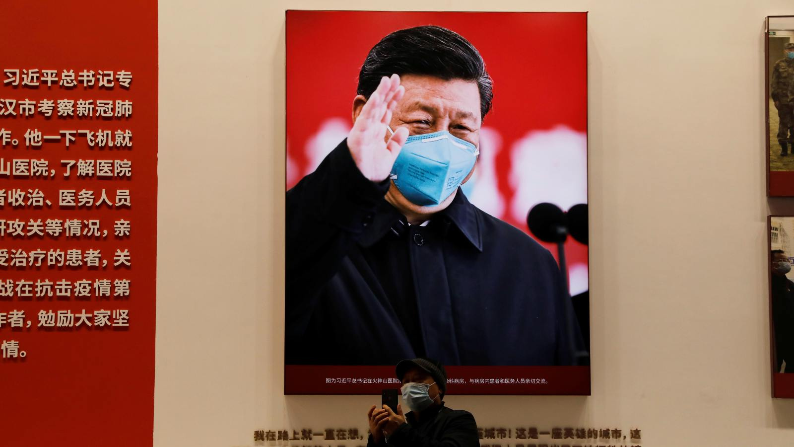 Photo: A visitor stands near an image of Chinese President Xi Jinping during an exhibition on the fight against the coronavirus disease (COVID-19) outbreak, at Wuhan Parlor Convention Center that previously served as a makeshift hospital for COVID-19 patients in Wuhan, Hubei province, China December 31, 2020. Credit: REUTERS/Tingshu Wang