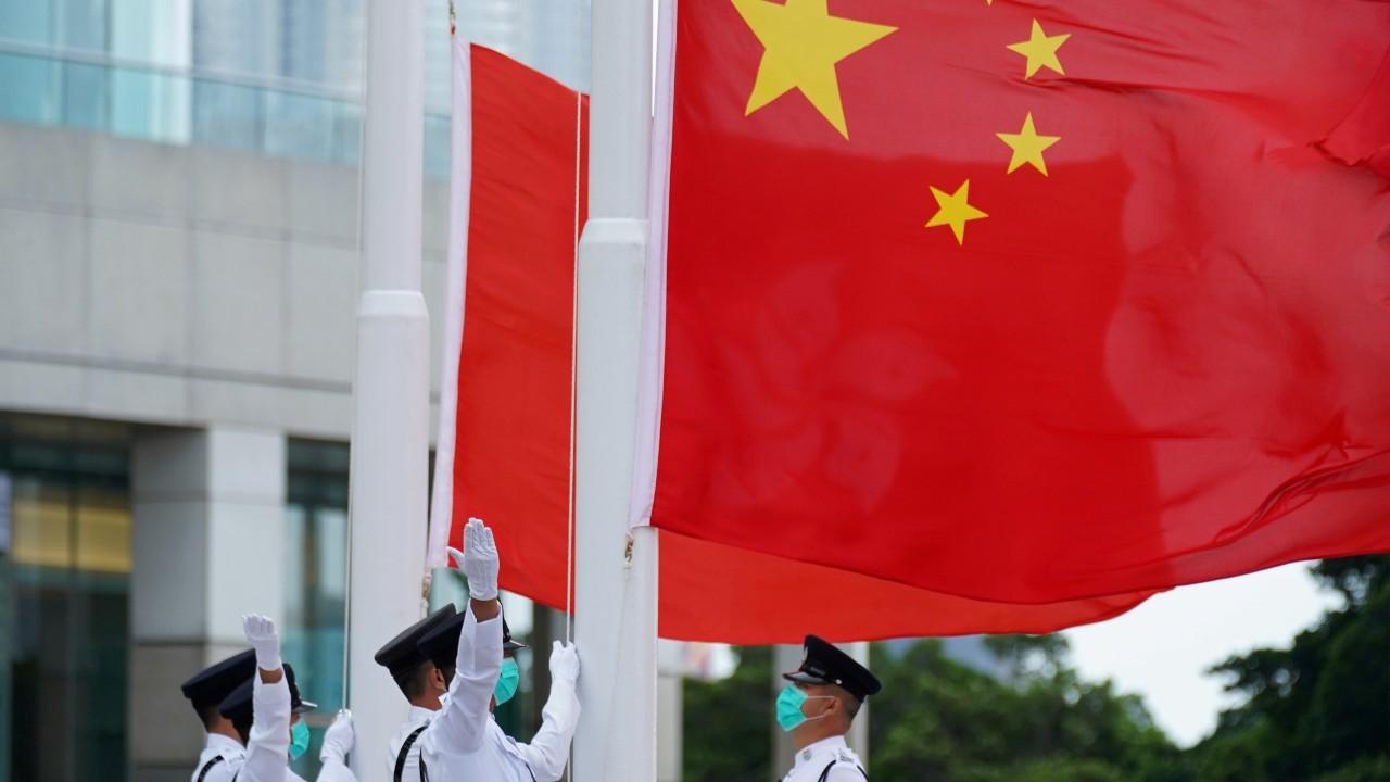 Photo: Members of the Hong Kong Police Honour Guard raise flags during a flag-raising ceremony marking China's National Day at Golden Bauhinia Square in Hong Kong, China October 1, 2020. Credit: REUTERS/Lam Yik/File Photo