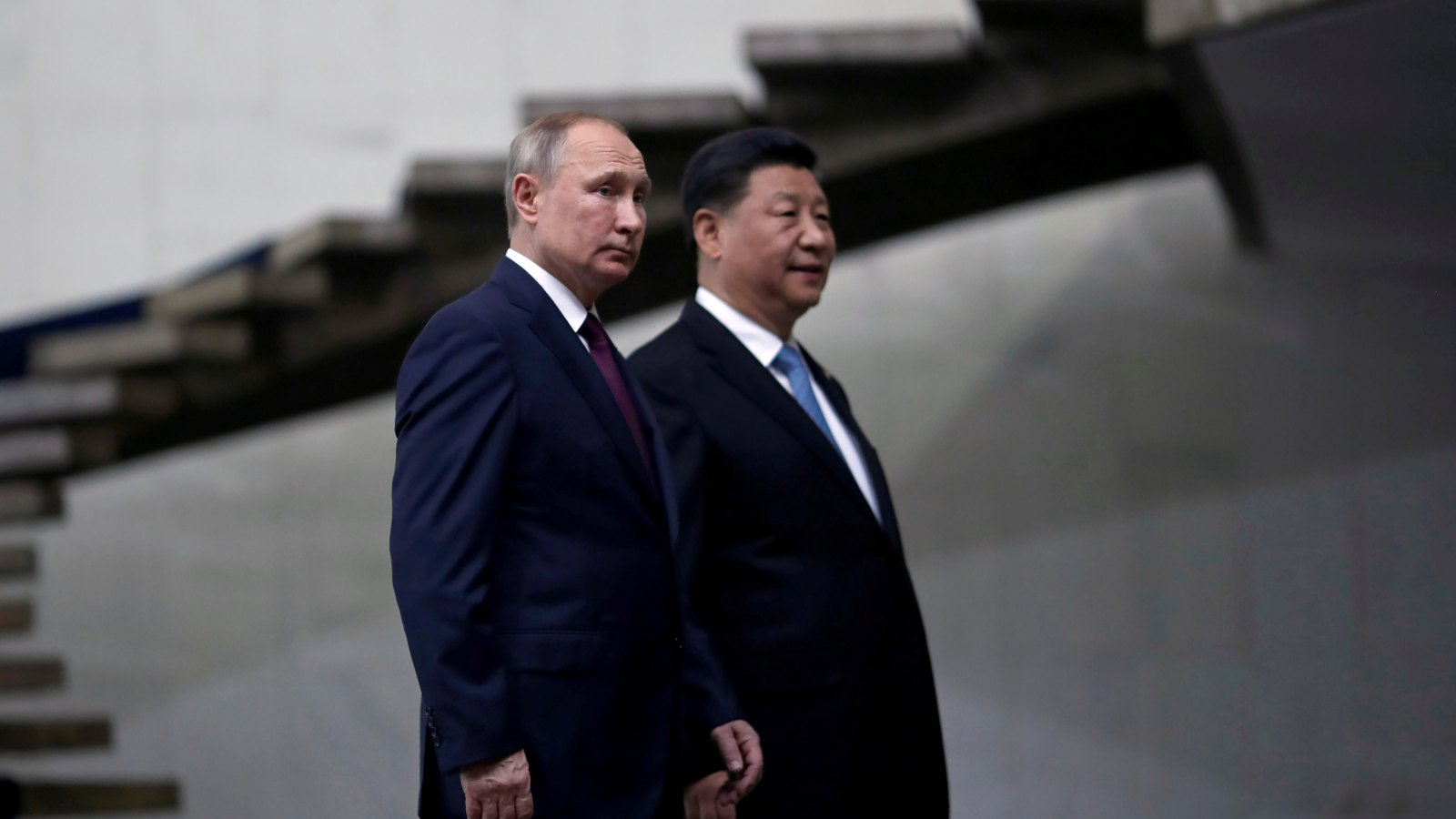 Russia's President Vladimir Putin and China's Xi Jinping walk down the stairs as they arrive for a BRICS summit in Brasilia, Brazil November 14, 2019.