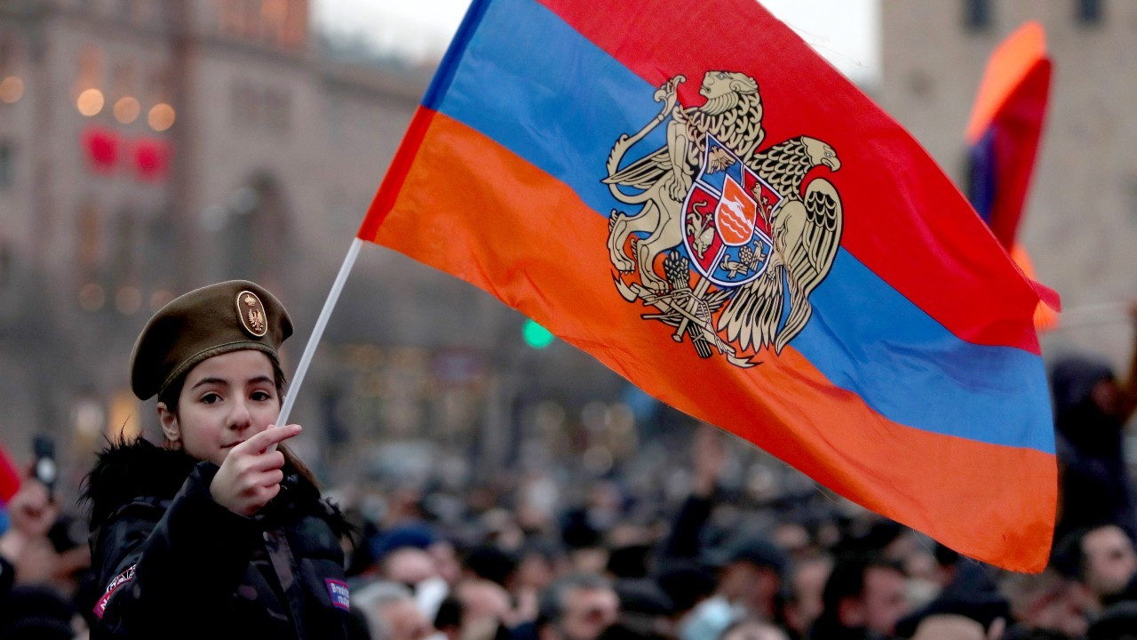Photo: YEREVAN, ARMENIA - MARCH 1, 2021: A girl holds an Armenian flag during a rally in support of Armenian Prime Minister Nikol Pashinyan outside the Armenian Government House in Republic Square. Credit: Hayk Baghdasaryan/Photolure/TASS