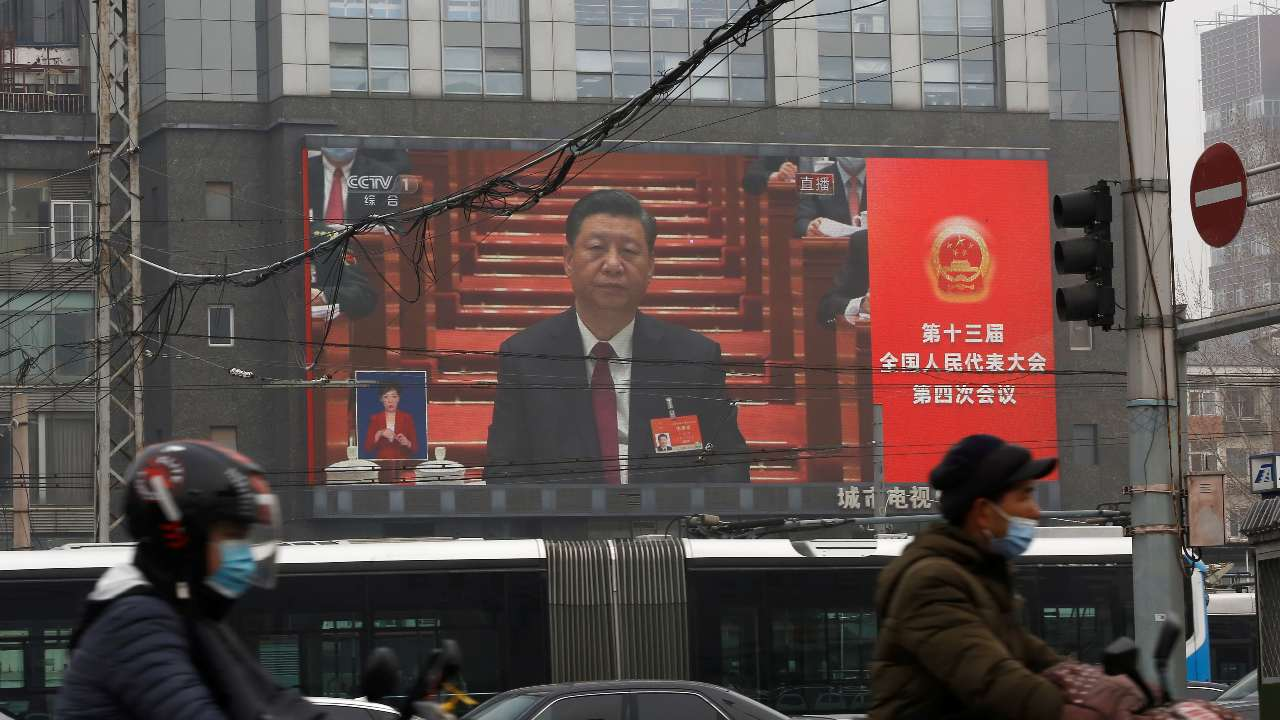 Photo: A giant screen shows Chinese President Xi Jinping attending the opening session of the National People's Congress (NPC) at the Great Hall of the People, in Beijing, China March 5, 2021. Credit: REUTERS/Tingshu Wang