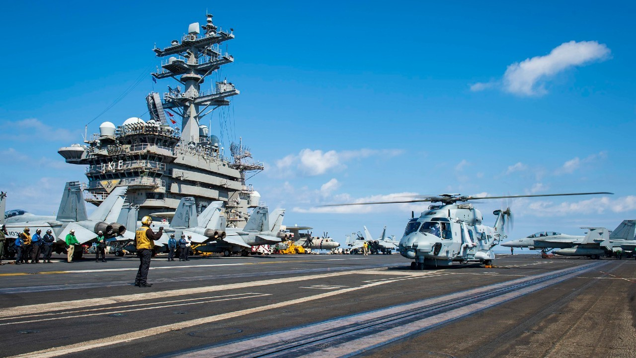 Photo: A French NH90 sits on the flight deck aboard the Nimitz-class aircraft carrier USS Dwight D. Eisenhower (CVN 69), in the Mediterranean Sea, March 27, 2021. The IKE Carrier Strike Group is on a scheduled deployment in the U.S. Sixth Fleet area of operations in support of U.S. national interests and security in Europe and Africa. Credit: U.S. Navy photo taken by Mass Communication Specialist 3rd Class Cameron Pinske