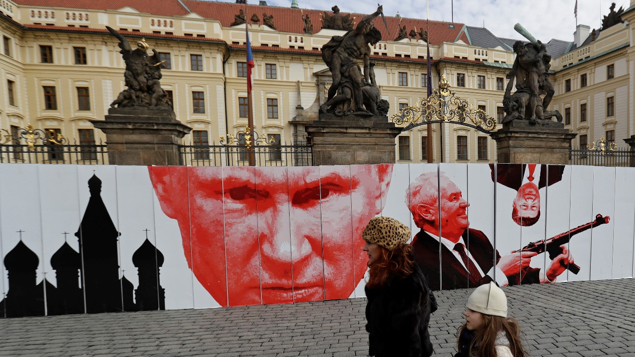 Photo: People walk past a paper wall depicting Russian President Vladimir Putin and Czech President Milos Zeman during a flash mob event in front of Prague Castle in Prague, Czech Republic, February 24, 2019. Credit: REUTERS/David W Cerny