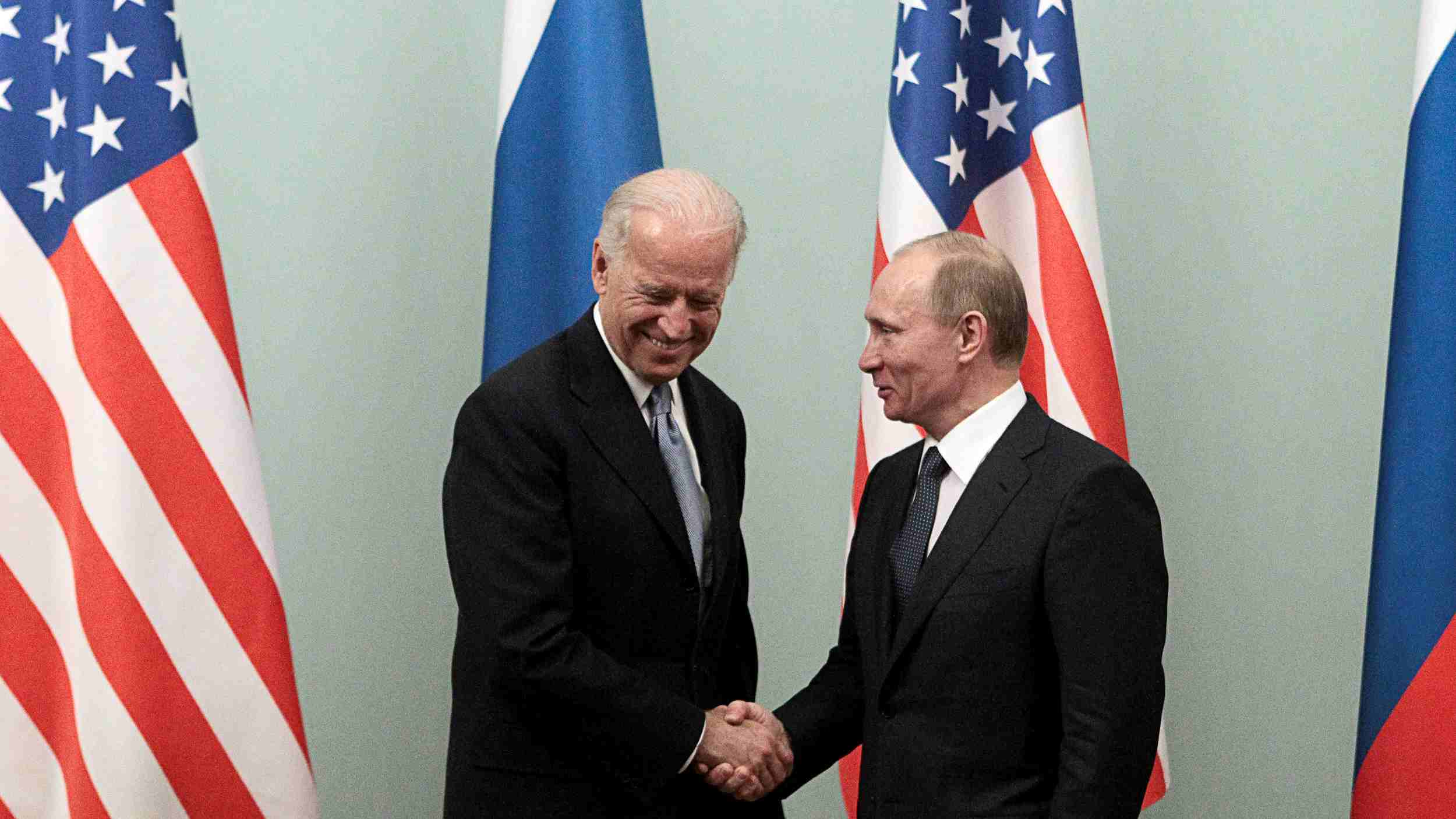 Photo: Russian Prime Minister Vladimir Putin (R) shakes hands with U.S. Vice President Joe Biden during their meeting in Moscow March 10, 2011. Credit: REUTERS/Alexander Natruskin/File Photo
