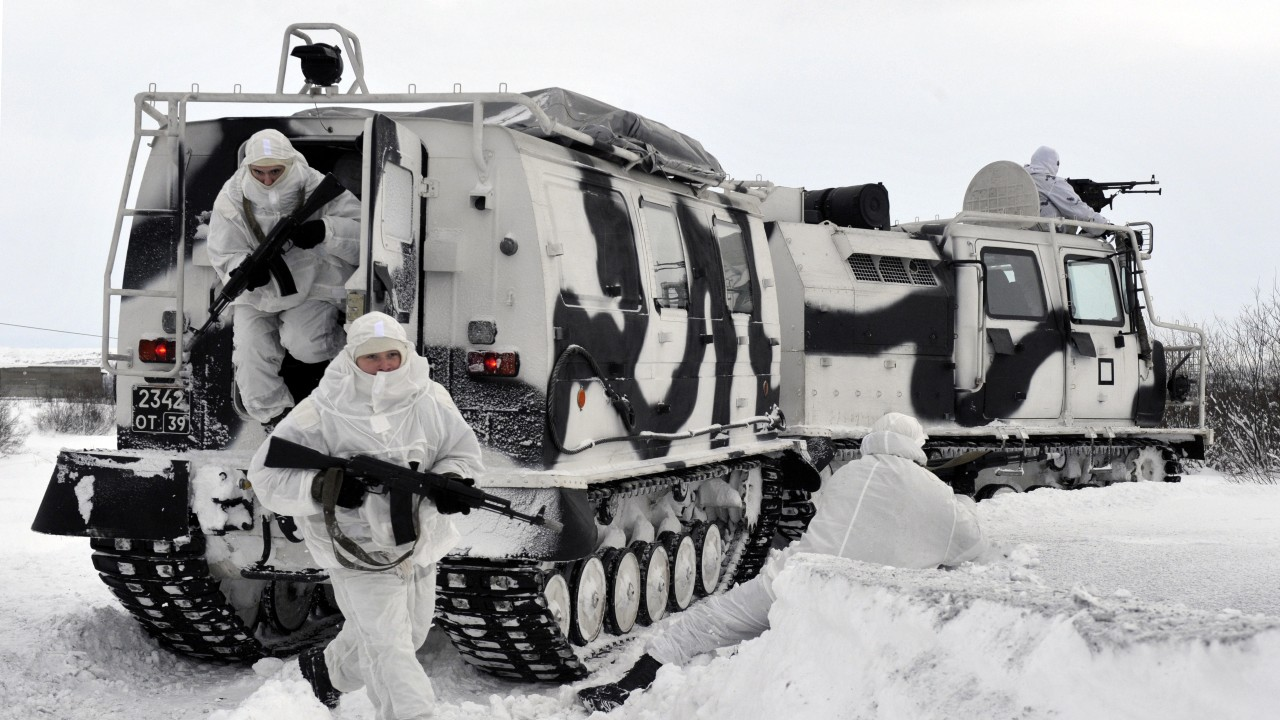 Photo: Servicemen of a separate motor rifle brigade of Russia's Northern Fleet are seen by Aleut all-terrain vehicles during a training exercise held as part of preparations for an Arctic expedition near the village of Pechenga. Aleut is an amphibious all-terrain vehicle that can be used at the temperature down to -50°C (-58°F). Credit: Lev Fedoseyev/TASS