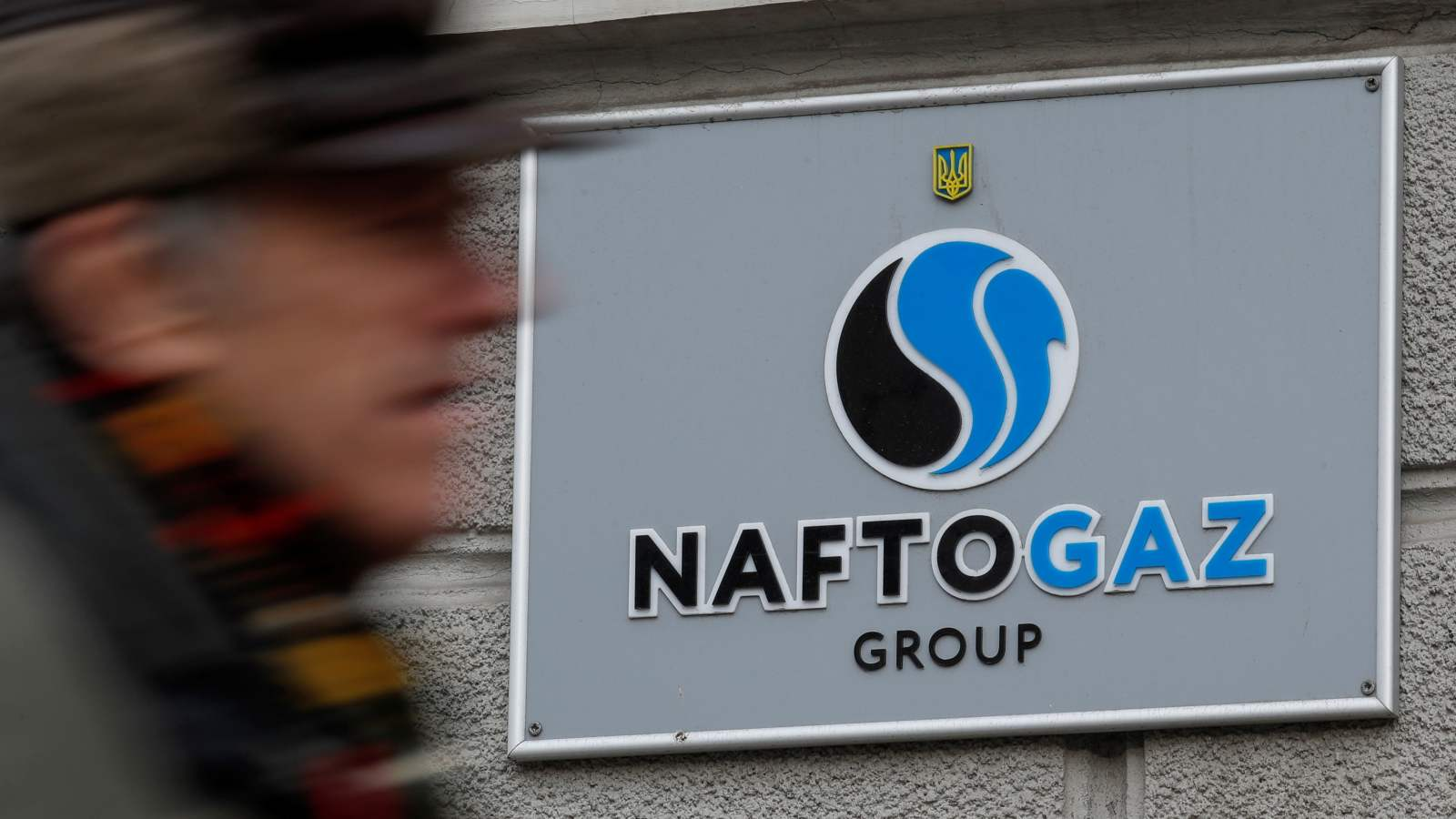 Photo: A man walks past the headquarters of the Ukrainian state energy company Naftogaz in central Kiev, Ukraine December 2, 2019. Credit: REUTERS/Valentyn Ogirenko/File Photo