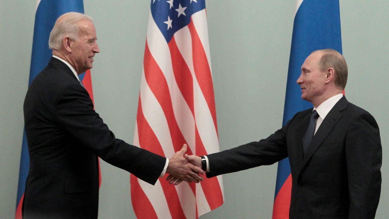 Photo: Russian Prime Minister Vladimir Putin (R) shakes hands with U.S. Vice President Joe Biden during their meeting in Moscow March 10, 2011. Credit: REUTERS/Alexander Natruskin