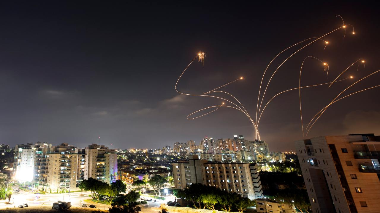 Photo: Streaks of light are seen as Israel's Iron Dome anti-missile system intercepts rockets launched from the Gaza Strip towards Israel, as seen from Ashkelon, Israel May 10, 2021. Picture taken with slow shutter speed. Credit: REUTERS/Amir Cohen