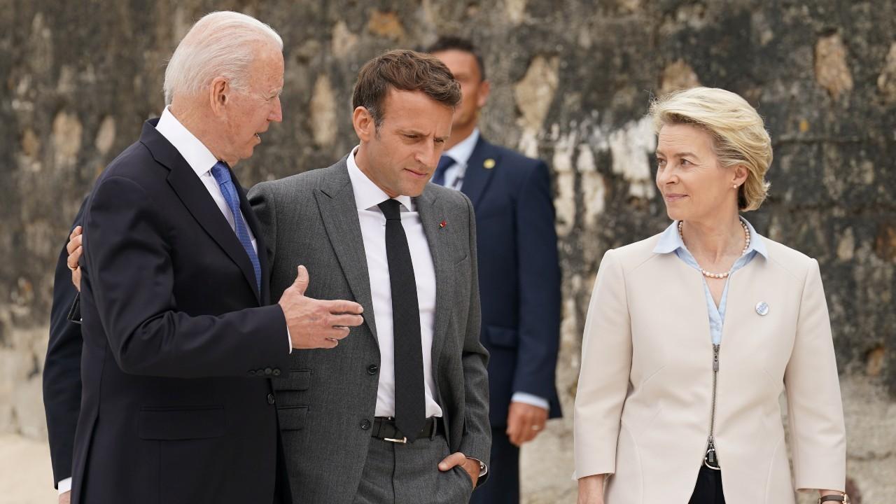 Photo: U.S. President Joe Biden, France's President Emmanuel Macron and European Commission President Ursula von der Leyen walk along the boardwalk during the G7 summit in Carbis Bay, Cornwall, Britain, June 11, 2021. Credit: REUTERS/Kevin Lamarque/Pool