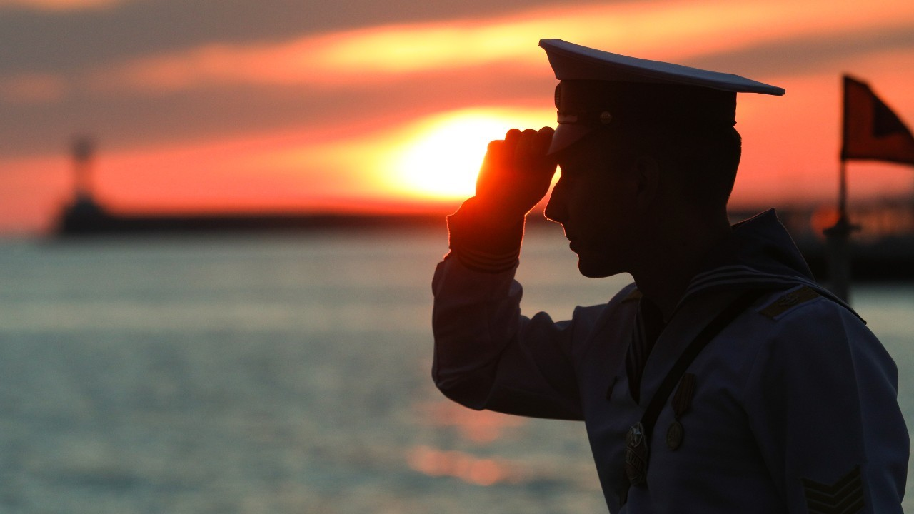 Photo: SEVASTOPOL, RUSSIA - JUNE 12, 2021: A serviceman stands by the Black Sea as he attends a celebration of Russia Day. Credit: Alexei Pavlishak/TASS