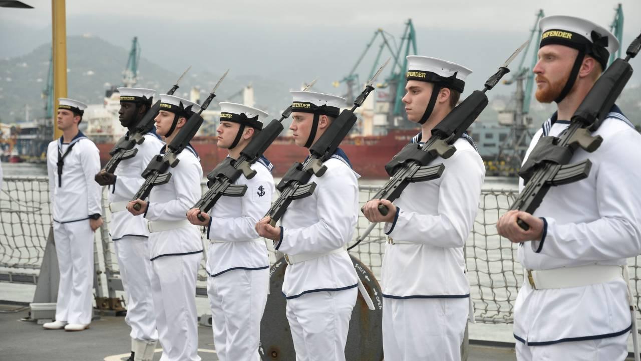 Photo: British Royal Navy members line up onboard the warship HMS Defender in the Black Sea port of Batumi, Georgia, June 26, 2021. Credit: Vasil Gedenidze/British Embassy in Georgia/Handout via REUTERS