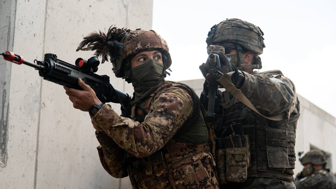 Photo: An Italian and Spanish soldier get ready for room-clearing drills during urban operations training as part of exercise Steadfast Defender 2021. Credit: NATO