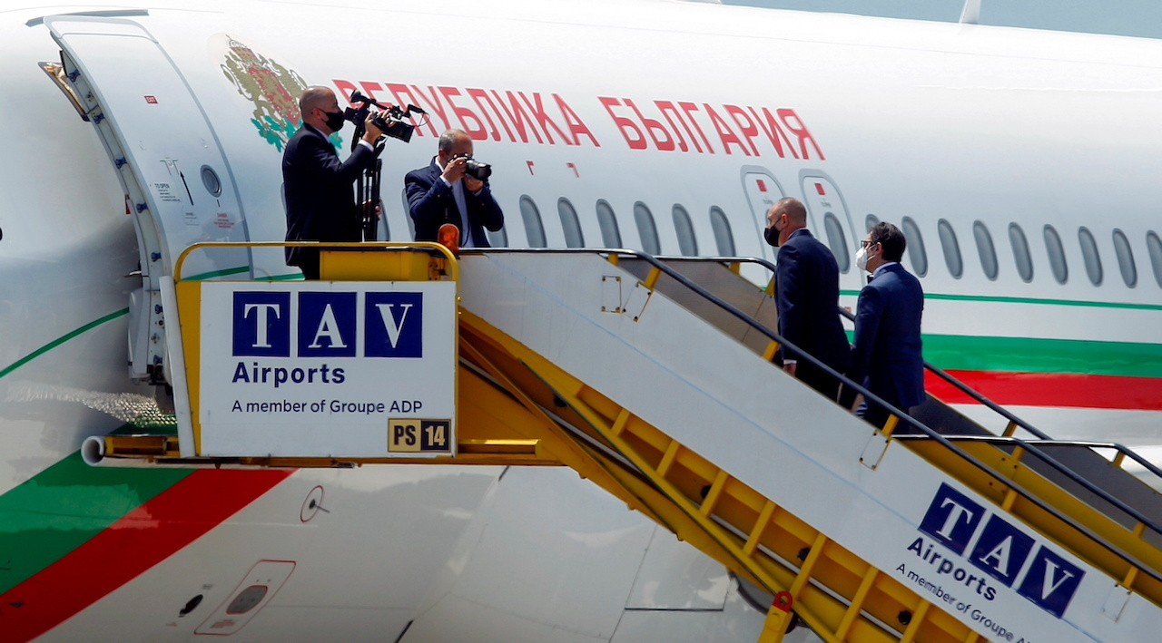 Photo: North Macedonian President Stevo Pendarovski and Bulgarian President Rumen Radev get on Bulgarian presidential airplane at Skopje airport ahead of a joint trip to Rome to visit the grave of St Cyril, in Skopje, North Macedonia May 26, 2021. Credit: REUTERS/Ognen Teofilovski