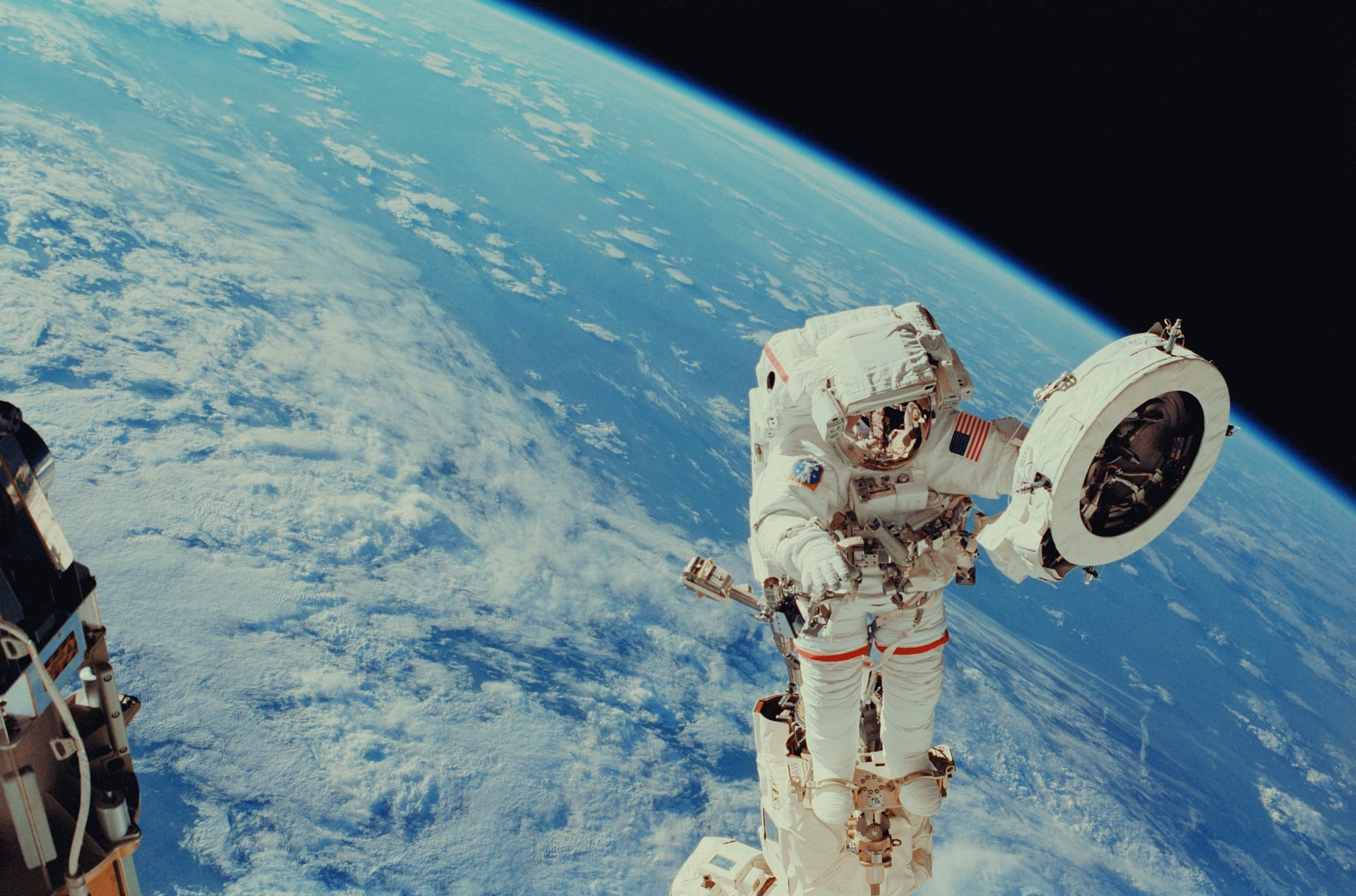 Photo: Astronaut Franklin R. Chang-Diaz works with a grapple fixture during extravehicular activity to perform work on the International Space Station. Credit: NASA.